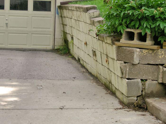 a failing retaining wall around a driveway in Jackson