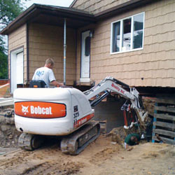 Excavating to expose the foundation walls and footings for a replacement job in Philadelphia