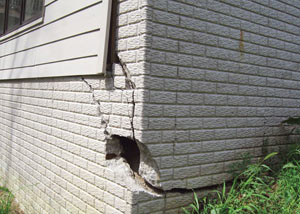 A severely damaged foundation wall in Canton