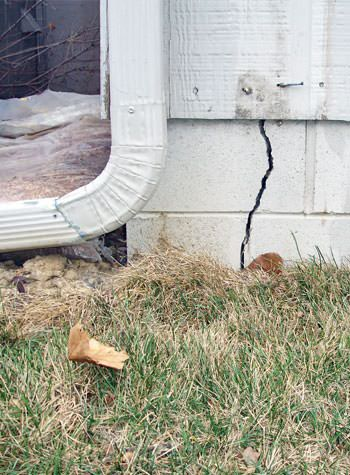 foundation wall cracks due to street creep in Raymond