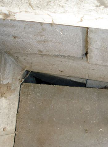 inward rotation of a foundation wall damaged by street creep in a garage in Morton
