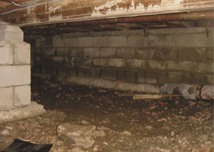 Rotting, decaying crawl space wood damaged over time in Raymond