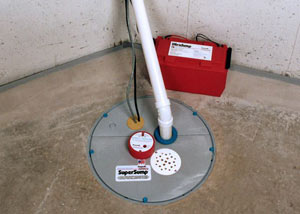 A sump pump system with a battery backup system installed in Hazlehurst